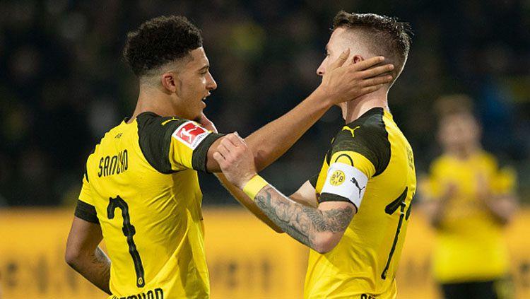 2 Bintang Borussia Dortmund, Jadon Sancho (kiri) dan Marco Reus. Copyright: © INDOSPORT