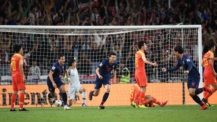 Thailand vs China. Copyright: © AFC