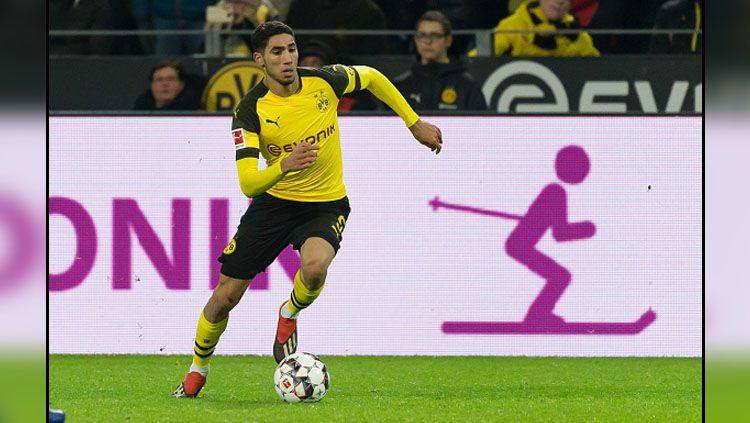 Achraf Hakimi, bek klub Bundesliga Jerman, Borussia Dortmund, menyampaikan sebuah kabar bahagia. Copyright: © Getty Images