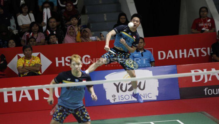 Kevin Sanjaya Sukamuljo/Marcus Fernaldi Gideon menghancurkan pasangan duo Jerman, Mark Lamsfuss/Marvin Seidel bisa merebut gelar juara Indonesia Masters dari tangan The Minions. Copyright: © Herry Ibrahim/INDOSPORT