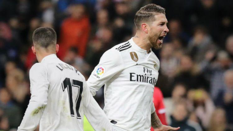 Indosport - Kapten Real Madrid, Sergio Ramos usai mencetak gol ke gawang Girona, Jumat (25/01/19).