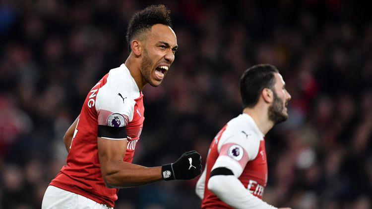 Striker Arsenal Pierre-Emerick Aubameyang merayakan gol ke gawang Manchester United di Piala FA, Sabtu (26/01/19). Copyright: © Twitter/@Coral