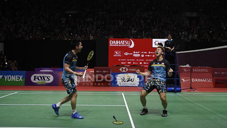 Pasangan ganda putra Indonesia, Kevin Sanjaya Sukamuljo/Marcus Fernaldi Gideon, tengah membidik gelar perdana mereka di turnamen bulutangkis Thailand Open 2019. Copyright: © INDOSPORT/Herry Ibrahim
