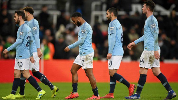 Para pemain Manchester City tertunduk lesu usai dikalahkan oleh Newcastle United, Rabu (30/01/19) dini hari tadi. Copyright: © Getty Images