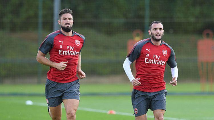 Olivier Giroud (kiri) dan Lucas Perez, 2 mantan pemain Arsenal. Copyright: © Getty Images