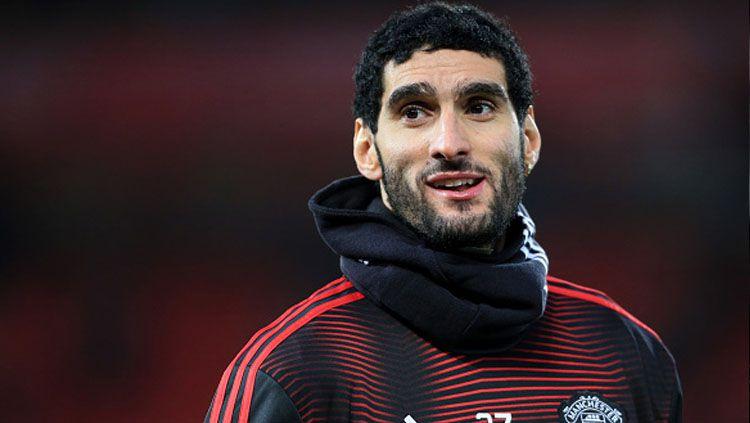 Marouane Fellaini adalah satu diantara sederet pesepak bola top Eropa yang jarang diketahui beragama Islam. Copyright: © Getty Images