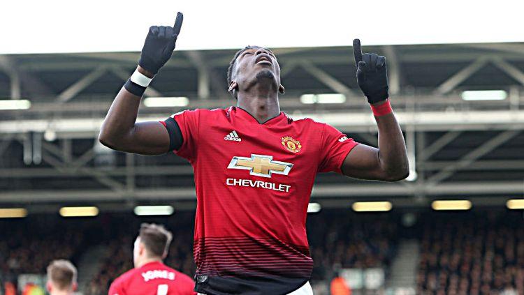 Selebrasi Paul Pogba (Manchester United) usai mencetak gol pertama ke gawang Fulham. Copyright: © GettyImages