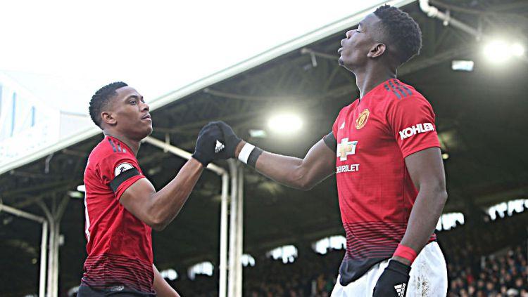 Selebrasi Anthony Martial dan Paul Pogba (Manchester United) saat merayakan usai mencetak gol ke gawang Fulham. Copyright: © GettyImages