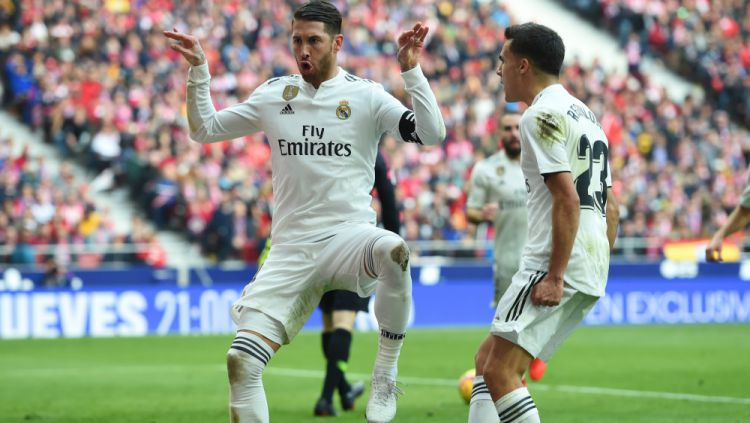 Selebrasi Sergio Ramos usai cetak gol ke gawang Atletico Madrid Copyright: © Getty Images