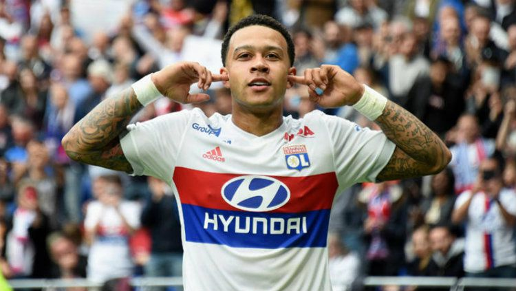 Mantan bintang Man United, Memphis Depay kini memperkuat Lyon di Prancis. Copyright: © Getty Images