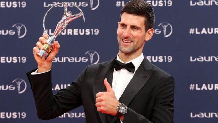 Novak Djokovic raih penghargaan di Laureus Awards 2019. Copyright: © Valery Hache/AFP/Getty Images