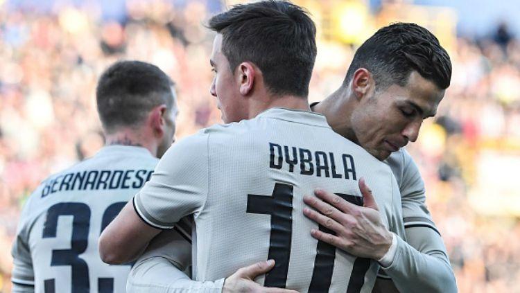 Paulo Dybala dan Cristiano Ronaldo saat di Juventus. Copyright: © Getty Images