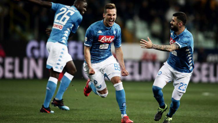 Arkadiusz Milik selebrasi gol dalam pertandingan Parma vs Napoli, Senin (25/02/19). Copyright: © Getty Images