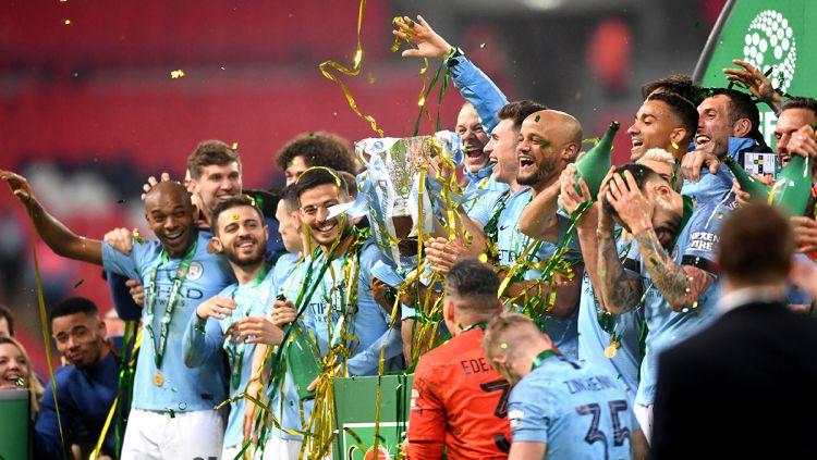 Pemain Manchester City merayakan kemenangan sebagai juara Piala Liga Inggris Copyright: © INDOSPORT