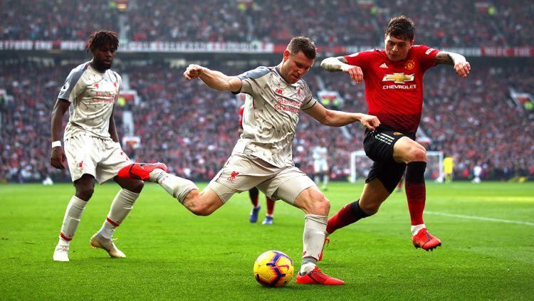 Liverpool dan Manchester United dikabarkan siap saling sikut demi memperebutkan jasa bocah muda ajaib klub gurem Liga Inggris. Copyright: © GettyImages
