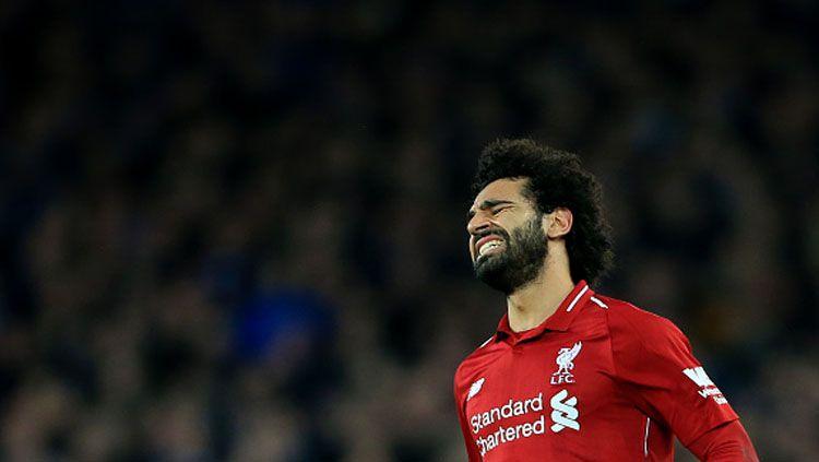 Ekspresi rasa kecewa dari pemain bintang Liverpool, Mohamed Salah. Copyright: © INDOSPORT