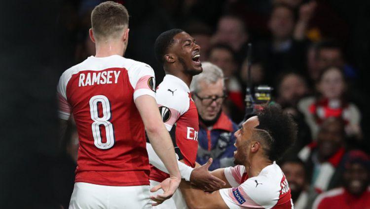 Selebrasi pemain Arsenal atas terjadinya gol melawan Rennes Copyright: © INDOSPORT