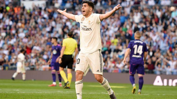 Real Madrid baru saja menjadi kampiun LaLiga Spanyol setelah Marco Asensio membawa mereka unggul atas Leganes dalam suatu turnamen FIFA 20. Copyright: © INDOSPORT.COM