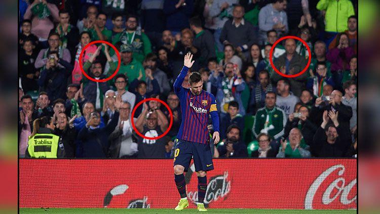 Pemain megabintang Barcelona, Lionel Messi mendapat standing applause dari fans Real Betis. Copyright: © INDOSPORT