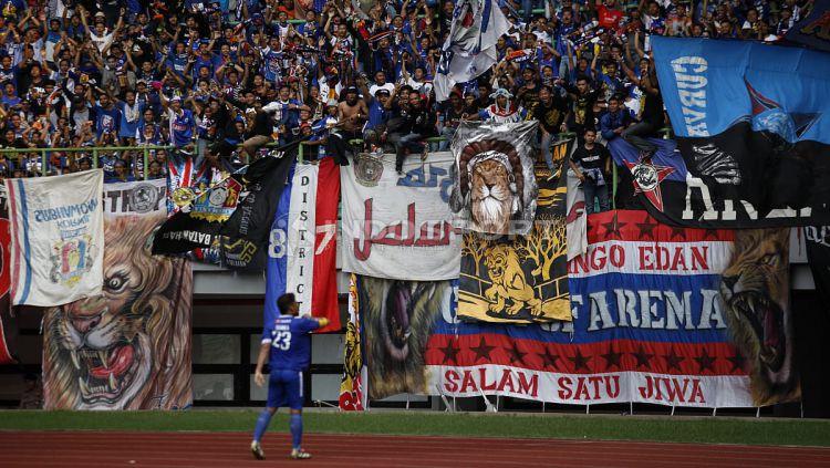 Panpel Arema FC membeberkan cara jitu untuk meredam aksi kurang terpuji suporter. Copyright: © Herry Ibrahim/Indosport.com