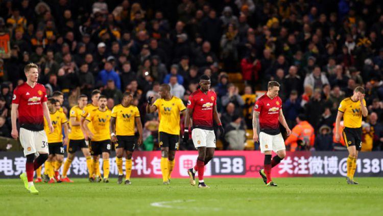 Skuat Man United tertunduk lesu pasca dikalahkan Wolves Copyright: © Catherine Ivill/Getty Images
