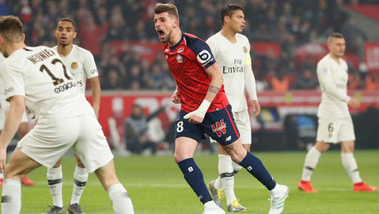 Ekspresi pemain Lille, Xeka usai mencetak gol ke gawang PSG. Copyright: © Catherine Steenkeste/Getty Images