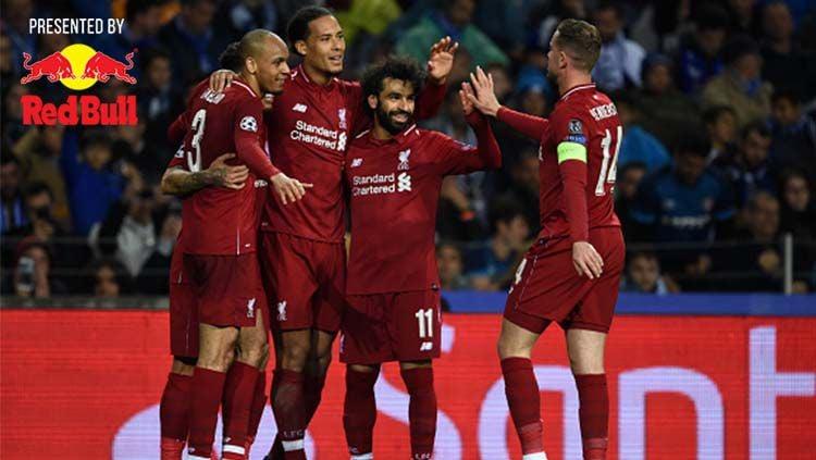 Skuat Liverpool merayakan gol ke gawang Porto di perempatfinal Liga Champions. Copyright: © Etsuo Hara / Contributor / Getty Images