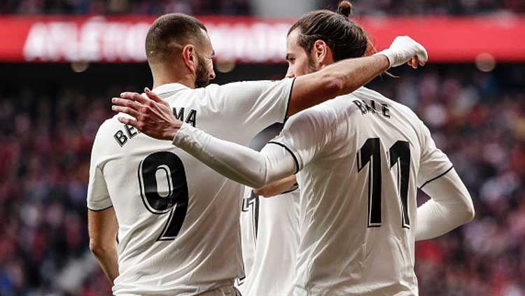 2 penggawa Real Madrid, Karim Benzema (kiri) dan Gareth Bale merayakan selebrasi bersama. Copyright: © Leonardo Prieto/GETTYIMAGES