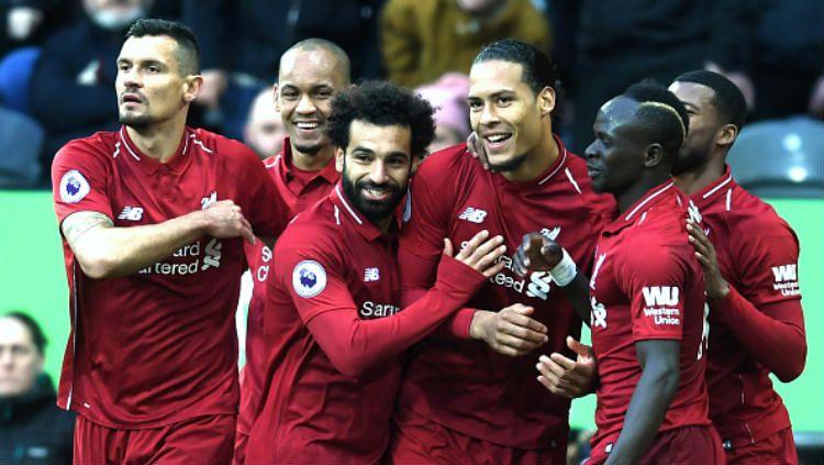 Para pemain Liverpool merayakan gol yang dicetak Van Dijk ke gawang Newcastle United Copyright: © Laurence Griffiths/Getty Images