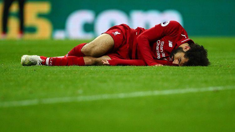 Pemain Liverpool, Mohamed Salah, terancam tidak bisa tampil melawan Crystal Palace setelah dipastikan absen membela Timnas Mesir di jeda internasional. Copyright: © Twitter @tvt_news