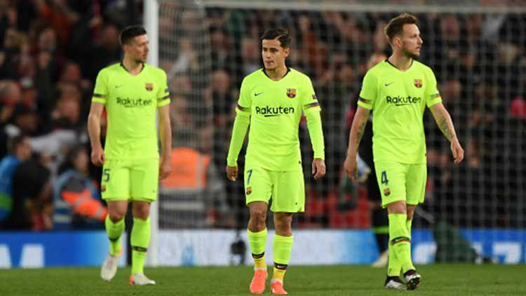 Philipe Coutinho (tengah) terlihat kecewa setelah Barcelona kalah dan gagal ke babak final Liga Champions 2018/19. Copyright: © Shaun Botterill/Getty Images