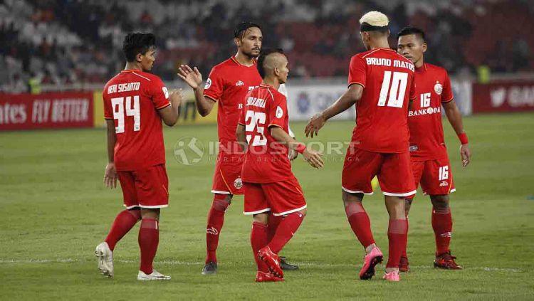 Selebrasi pemain-pemain Persija Jakarta usai menjebol gawang Shan United pada laga terakhir Grup G Piala AFC 2019. Foto Herry Ibrahim/INDOSPORT Copyright: © Herry Ibrahim/INDOSPORT