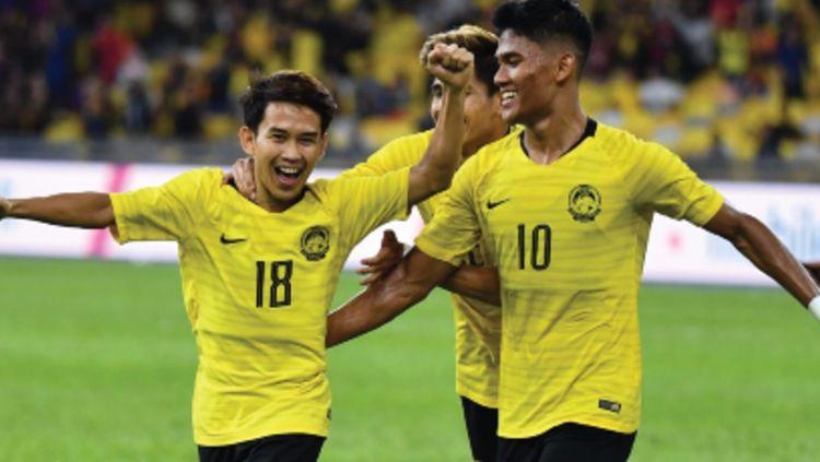 Selebrasi Timnas Malaysia di pertandingan putaran pertama Kualifikasi Piala Dunia 2022 zona Asia. (Foto: the-afc.com) Copyright: © the-afc.com