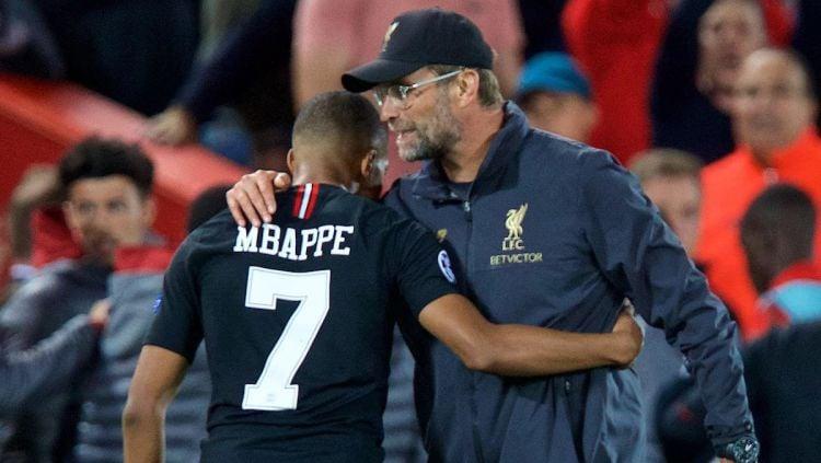 Kylian Mbappe bisa saja pindah dari klub Ligue 1 Prancis, PSG, ke Liverpool ketimbang Real Madrid. Copyright: © This Is Anfield