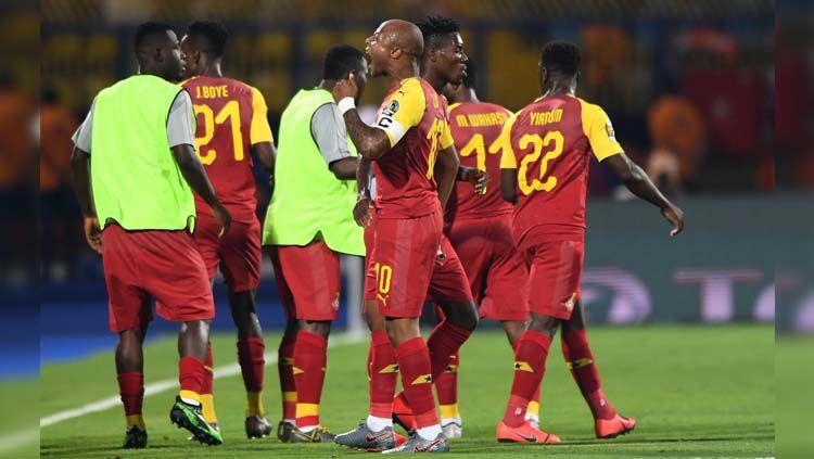 Andre Ayew merayakan gol pada laga Ghana vs Benin di Piala Afrika 2019, Rabu (26/06/19). Copyright: © Twitter/@24SaatFutbolcom