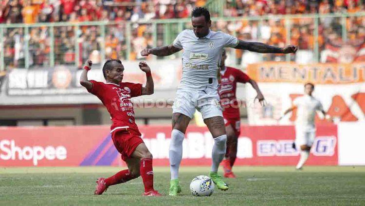 Persija Jakarta dan PSS Sleman dilaporkan akan memainkan laga pembuka Liga 1 2021. Copyright: © Herry Ibrahim/INDOSPORT