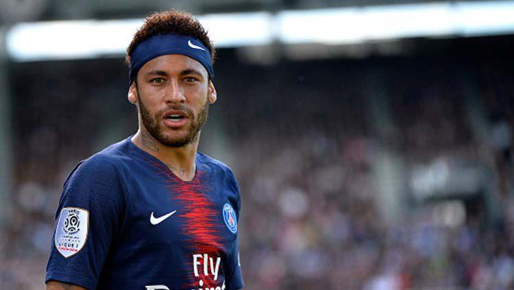 Penyerang Paris Saint-Germain, Neymar, dikabarkan kian dekat dengan Real Madrid karena Barcelona tak sanggup menebus harganya. Copyright: © Aurelien Meunier - PSG/PSG via Getty Images