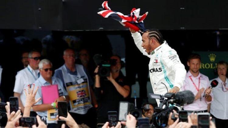 Lewis Hamilton menjadi pemenang di F1 GP Belgia 2020. Copyright: © Matthew Childs/Reuters