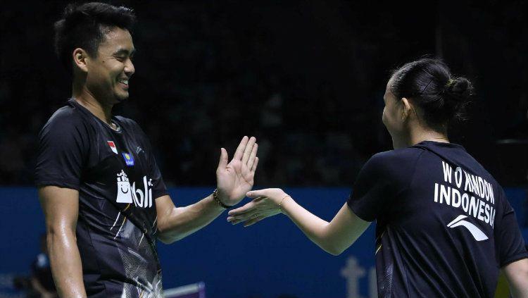 Pasangan ganda campuran Indonesia, Tontowi Ahmad/Winny Oktavina Kandow, mendapat kritik pedas usai gagal di turnamen bulutangkis Japan Open 2019. Copyright: © Humas PP PBSI