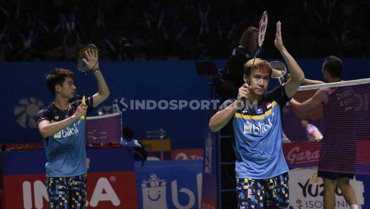 Ganda putra Indonesia, Kevin Sanjaya/Marcus Fernaldi melaju ke semifinal Indonesia Open 2019 setelah mengalahkan ganda China, Zhang Nan/Ou Xuan Yi dengan skor 21-12 dan 21-16 di Istora Senayan, Jumat (19/07/19). Foto: Herry Ibrahim/INDOSPORT Copyright: © Herry Ibrahim/INDOSPORT