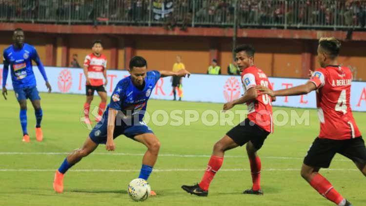 Madura United berhasil menang tipis 1-0 atas Arema FC pada laga Shopee Liga 1 2019, Sabtu (20/07/19). Ian Setiawan/INDOSPORT. Copyright: © Ian Setiawan/INDOSPORT