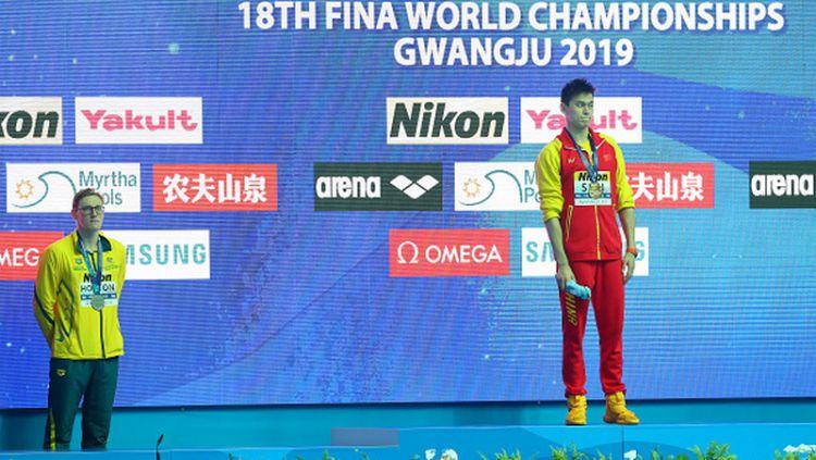 Mack Horton (kiri) menolak satu podium bersama perenang China, Sun Yang Copyright: © Maddie Meyer/Getty Images