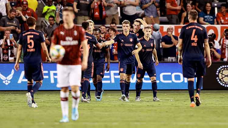 Pemain Bayern Munchen melakukan selebrasi setelah Leon Goretzka mencetak gol ke gawang AC Milan. Copyright: © Jamie Squire/International Champions Cup via Getty Images