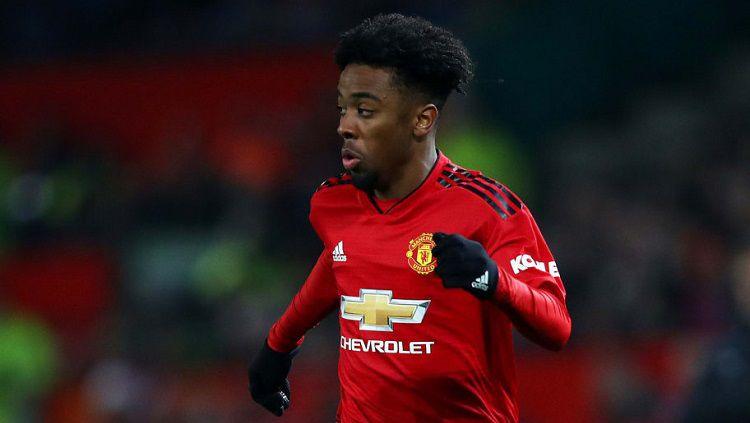 Pemain Manchester United, Angel Gomes, melakukan hal mulia setelah mendengar kabar duka yang menimpa seorang penggemar Arsenal. Clive Brunskill/Getty Images. Copyright: © Clive Brunskill/Getty Images