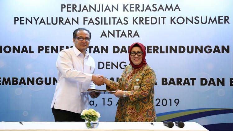 Bank bjb melaksanakan penandatanganan perjanjian kerja sama (PKS) penyaluran Kredit Konsumer dengan Badan Nasional Penempatan & Perlindungan Tenaga Kerja Indonesia (BNP2TKI). Copyright: © Corporate Secretary Bank bjb