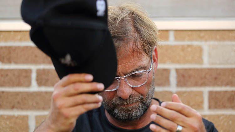 Jurgen Klopp, pelatih Liverpool, memilih merendah meski kini tengah berjaya di Liga Inggris dan baru saja menjuarai Liga Champions. Copyright: © Matthew Ashton/GettyImages