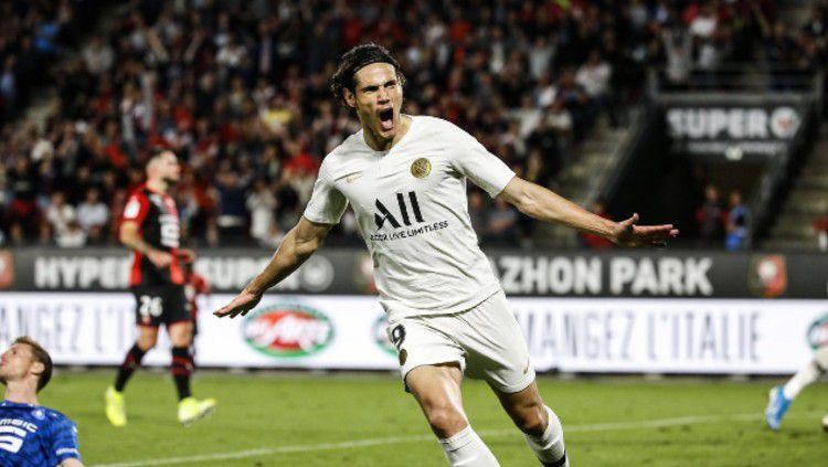 Bintang Paris Saint Germain (PSG), Edinson Cavani dikabarkan benar-benar serius ingin memperkuat Inter Milan. Copyright: © Media PSG