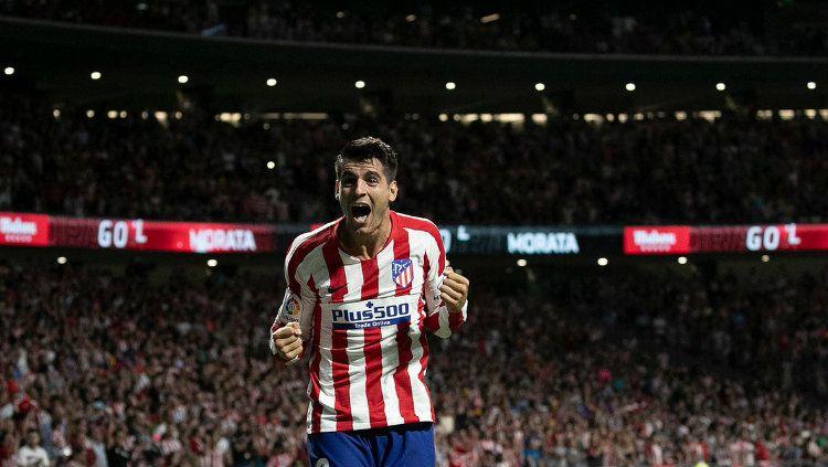 Alvaro Morata mengaku bahagia usai meninggalkan Chelsea dan berlabuh ke Atletico Madrid. Copyright: © twitter.com/atletienglish