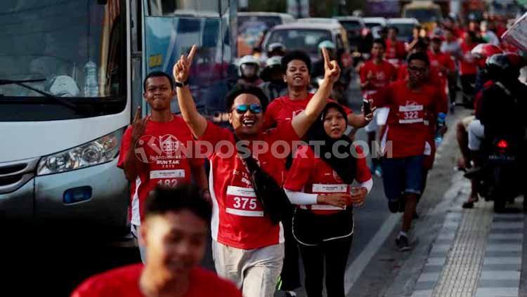 Ratusan pelari dari mengikuti lomba bertajuk De Tjolomadoe Run 7.4K, Sabtu (24/08/19). Copyright: © Ronald Seger Prabowo/INDOSPORT