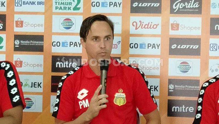 Pelatih Bhayangkara FC, Paul Munsters, berencana mengisi waktu setelah PSSI memutuskan untuk menunda sementara Liga 1 dan Liga 2. Copyright: © Shintya Anya Maharani/INDOSPORT